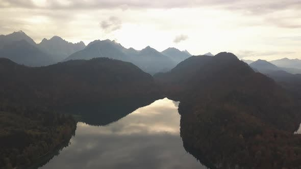 Thumbnail for AERIAL: Flight Over Mountain Lake in Europe,german Alps with Reflection and Mountain Silhouette,
