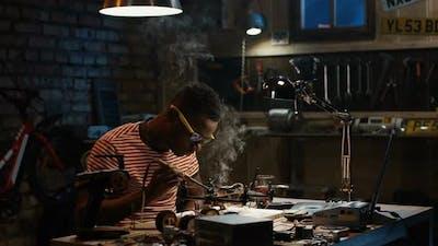Man Repairing a Drone