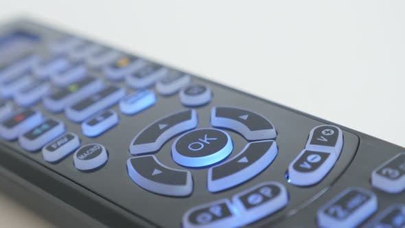 Thumbnail for Buttons lighted on multimedia remote control close-up video