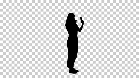 Thumbnail for Silhouette Woman using lipstick and looking in her phone