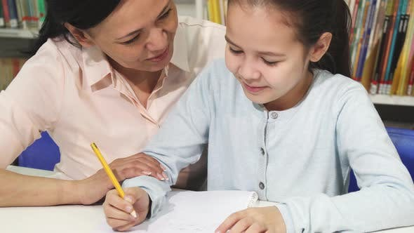 Thumbnail for Adorable Little Girl Doing Homework with Her Mother