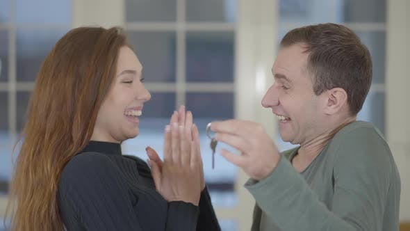 Thumbnail for Portrait of a Happy Married Couple Showing the Keys of a Purchased New House or Apartment