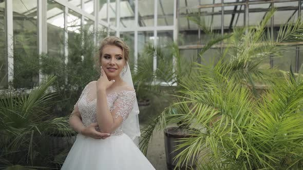 Thumbnail for Beautiful and Lovely Bride in Wedding Dress in the Park. Slow Motion
