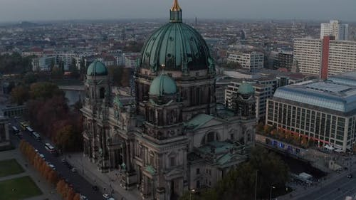 AERIAL: Close Up of Berlin Cathedral, Germany in Fall Colors at Beautiful Sunset