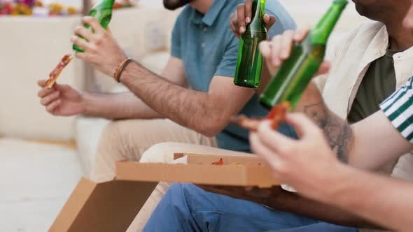 Thumbnail for Male Friends Eating Pizza with Beer on Rooftop