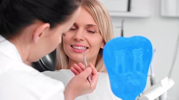 Thumbnail for Dentist Examining Woman's Teeth in Dentist's Office