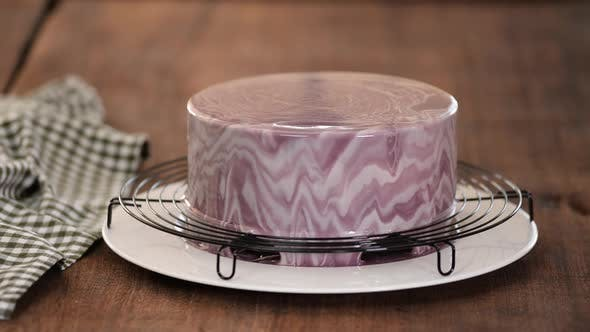 Thumbnail for Close Up of Professional Chef Covering the Glaze Cake. Woman Decorating Cakes with Mirrored Glaze.