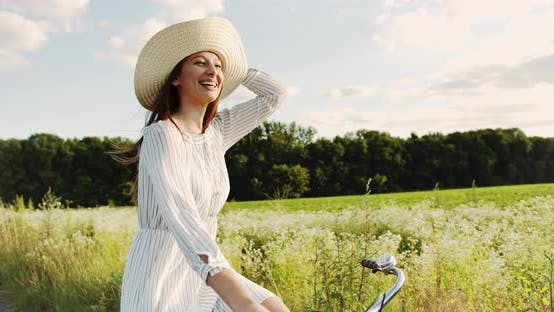 Thumbnail for Happy Woman Riding Bicycle on Country Road