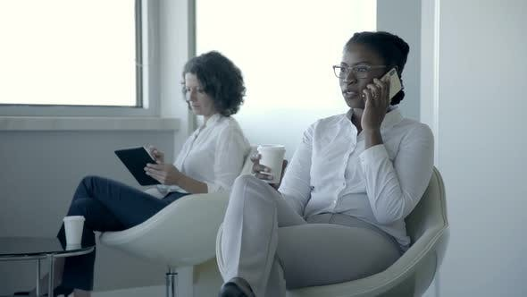 Thumbnail for Multiethnic Businesswomen with Digital Devices