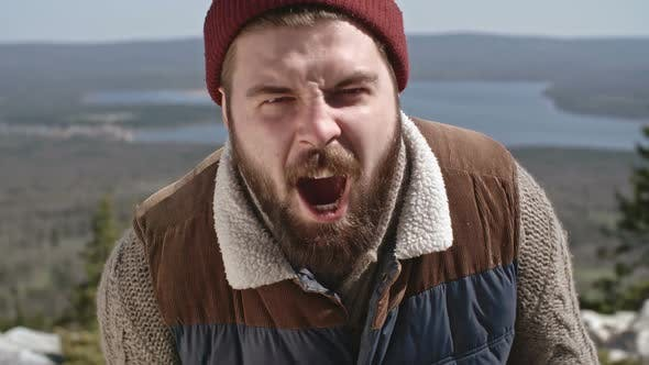 Cover Image for Man with Beard Screaming on Hiking Trip