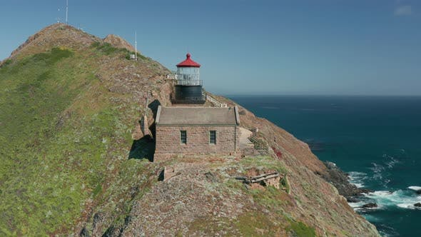 Thumbnail for Aerial Close Up Overlook of the Historical Building of Lighthouse with Red Roof