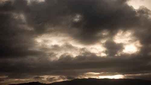 Sun Rays Moving of Behind the Clouds