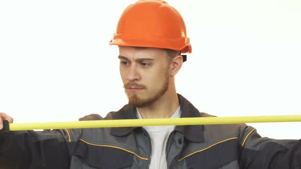 Cover Image for Young Male Engineer Making Measurements Isolated