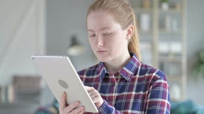 Close Up of Young Woman Using Tablet