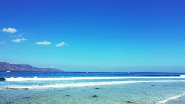 Thumbnail for Wide birds eye abstract view of a sunshine white sandy paradise beach and aqua blue ocean background