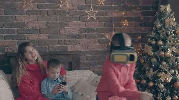 Blond Boy with Modern Virtual Reality Glasses on Head Fights