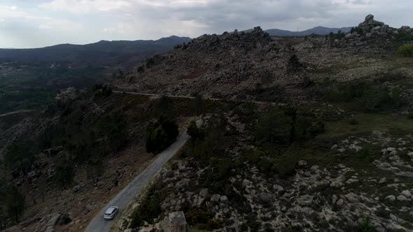 Thumbnail for Cinematic Aerial View Of Vehicle Driving Road