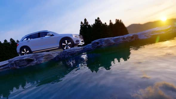 Thumbnail for White Luxury Off-Road Vehicle Moving On Rock Road In Mountainous Area At Sunset