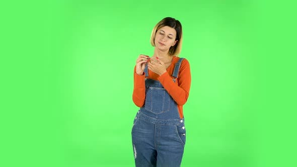 Thumbnail for Girl Makes Herself Manicure with Pink Nail File. Green Screen