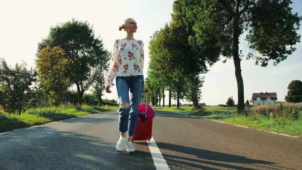 Thumbnail for Cheerful Young Woman with Suitcase Walking on Road