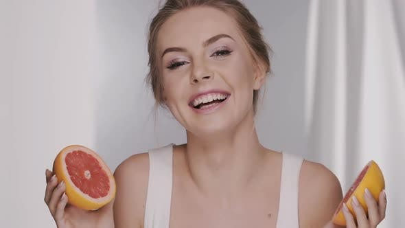 Thumbnail for Girl Hiding Her Face with Pieces of Fruit Lauging and Being Surprised