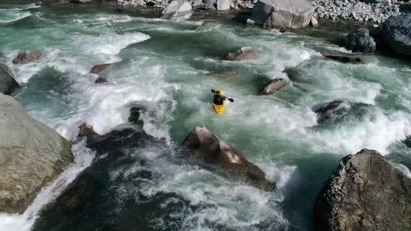 Thumbnail for Whitewater Kayak Aerial Charging Rocky Rapids