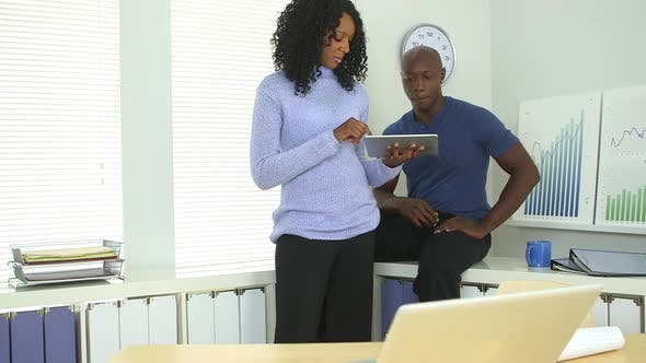 Thumbnail for African American business colleagues working hard in office