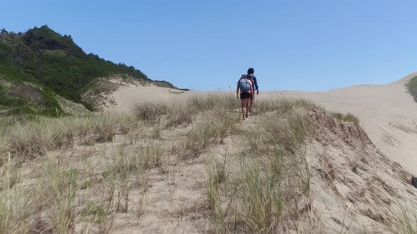 Thumbnail for Couple hiking on sand dunes