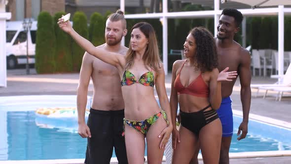 Multiracial Friends Posing for Selfie Near Pool