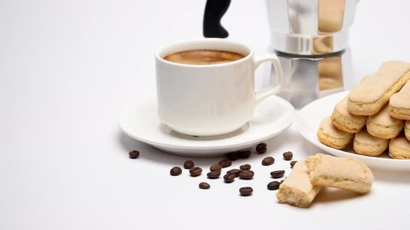 Thumbnail for White Ceramic Cup of Coffee with a Savoiardi Ladyfinger Cookie on a Plate