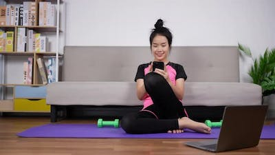 Woman training with smartphone