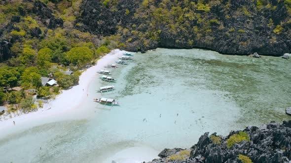 Thumbnail for Taking Rest in Noon on Star Beach on Tapiutan Island Near Matinloc Shrine. El Nido, Palawan