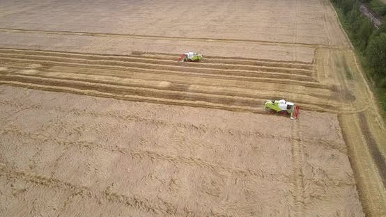 Thumbnail for Aerial Motion Above Field To Tractors Gathering Harvest