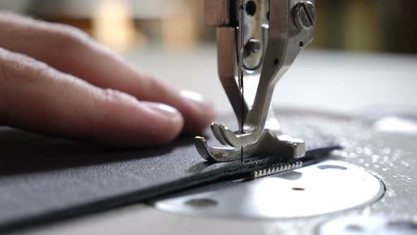 Thumbnail for Craft Man at Work. Workshop of Making Leather Bag - Craftsman Stitches the Pouch on Sewing Machine
