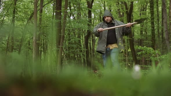 Thumbnail for Close-up Of Working with Big Ax in Wild Deciduous Forest.