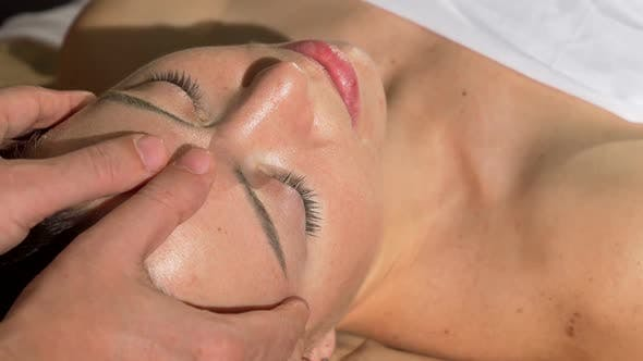 Cover Image for Mature Woman Enjoying Relaxing Head and Face Massage at Spa