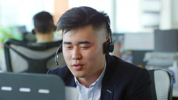 Asian Man Working in Customer Service