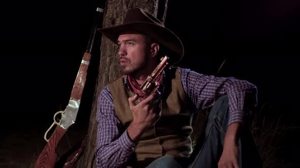 Thumbnail for Cowboy with a Gun in the Forest at Night