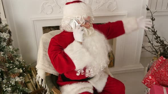 Thumbnail for Santa Claus Talking Over the Phone Wishing Merry Christmas