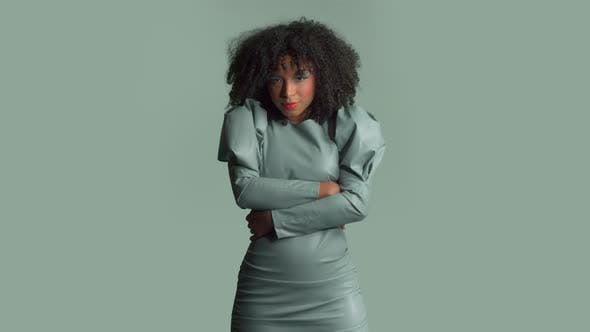 Thumbnail for Mixed Race Woman with Big Curly Hair in Leather Fashion Dress in Studio