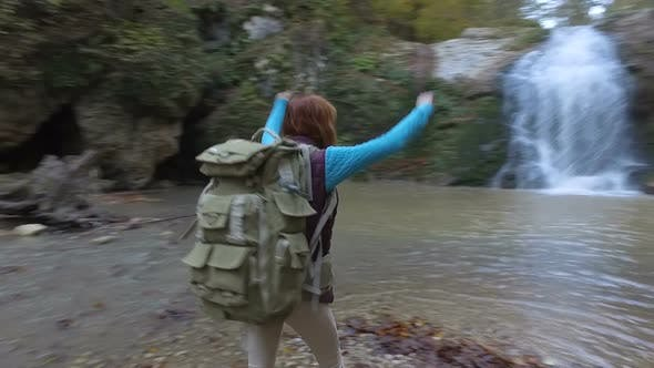 Cover Image for Red-haired Young Woman Tourist With Backpack Travels