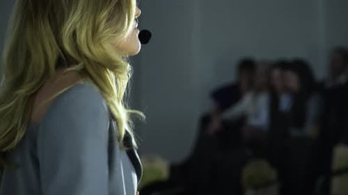 Female Speaker Presentation at Exposition Center