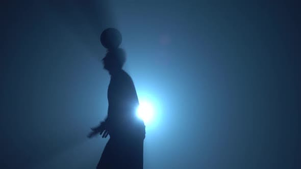 Thumbnail for Close-up Football Freestyle at Studio Against Spotlight