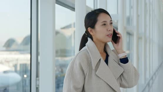 Businesswoman Talk to Cellphone in The Airport