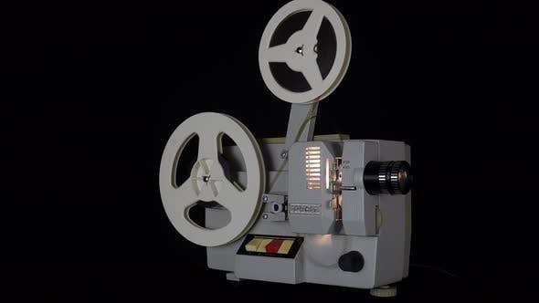Watching Films On An Old Film Projector.