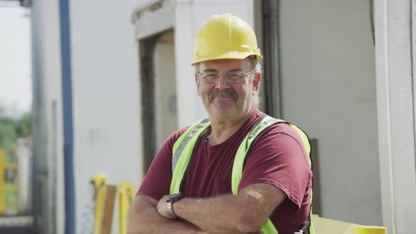 Portrait of truck driver at shipping facility.  Fully released for commercial use.