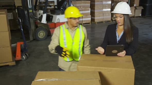 Thumbnail for Workers using digital tablet in shipping warehouse