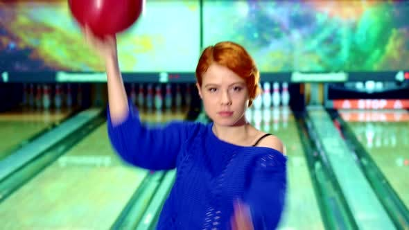 Thumbnail for Girl Spins with Bowling Ball in Her Hands