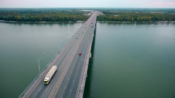 Cover Image for Beautiful View of the Bridge Over the River, Passing Cars Through the Bridge, Aerial