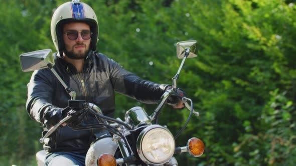 Thumbnail for Young man riding a Yamaha